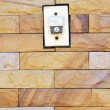 Buzzer switch on brick wall — Stok fotoğraf
