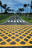 Yellow cross line area on the asphalt road surface — Stock Photo