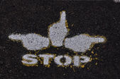 Stop symbol on the road surface — Stock Photo