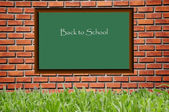 Black board school and brickwall pattern — Stock Photo
