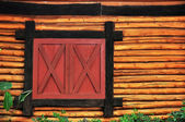 Log wood and window — Stock Photo