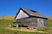 Hut of the shepherd on a hillside — Foto Stock