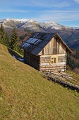 Hut on a hillside. — Stock Photo