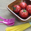 Tomato on wood plate - Stock Photo
