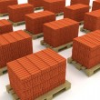 Lot of stacks of orange bricks with pallets isolated — Stock Photo