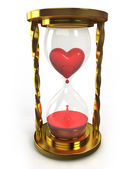 Golden hourglass with heart and blood — Stock Photo