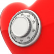 Red heart with a numeric safe lock closeup — Stock Photo