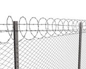 Chainlink fence with barbed wire on top — Стоковое фото