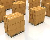 Un montón de pilas de cajas de cartón en una plataformas — Foto de Stock