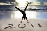 Happy new year 2011 on the beach — Stock fotografie