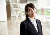 Young beauty and smiling business woman — Stock Photo