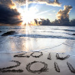 Stock Photo: 2010 to 2011 on beach