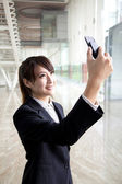 Businesswoman taking picture by camera — Stock Photo