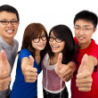 Four young teenagers laughing — Stock Photo