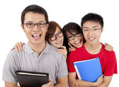 Happy students standing together with fun — Stockfoto