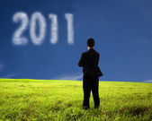 Businessman thinking and watching the 2011 — Stock Photo