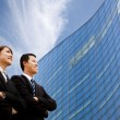Business team standing together in front of modern building — Stok Fotoğraf #4346184