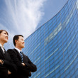 Business team standing together in front of modern building — Stock Photo