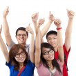 Happy students showing thumbs up and isolated on white background — Stock Photo