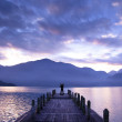 Man stand on a pier and watching the mountains and lake — Stock Photo #4446982