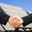 Businessman shaking hand before Solar power plant — Stock Photo