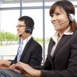 Royalty-Free Stock Photo: Smiling customer service representative in modern office with a headset