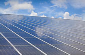 Large solar photovoltaic with cloud Reflection — Stock Photo