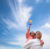Happy girl and father with cloud background — Stock Photo