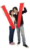 Chinese new year. Young Asian couple holding blank spring festival couplet — Stock Photo