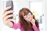 Young asian woman take photo by her cell phone — Stock Photo