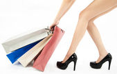 Woman legs and shopping bags.Isolated with white background. — Stock Photo