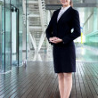 Fullbody business woman smiling and stand in morden office — Stock Photo