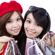 Two Beauty shopping sisters isolated on white background - Stock Photo