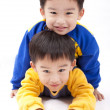 Stock Photo: Twin brothers.two happy boys.Isolated with white background.