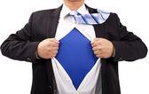 Affärsman med mod och superman koncept — Stockfoto