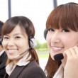 Similing business customer service team on phone — Stockfoto #5086669
