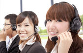 Similing business customer service team on the phone — Stok fotoğraf