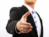 Close up of business man extending hand to shake — Stockfoto