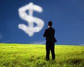 Businessman thinking and watching the money mark of cloud — Stock Photo