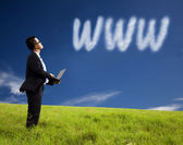 Internet cloud computing concept. businessman using laptop and watching int — Stock Photo