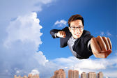 Businessman fly in sky over the city — Stock Photo