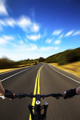 Bicycle rider with high speed view on the road — Stock Photo