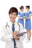 Las enfermeras y el médico joven sonriente — Foto de Stock