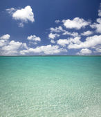 Clean blue water beach and cloud — ストック写真