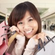 Happy asian woman in a shopping mall — Stock Photo #5283000