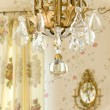 Stock Photo: Chandelier and sconce on wall