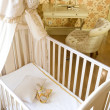 Baby room with crib and toys - Stock Photo