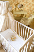 Baby room with crib and toys — Stock Photo