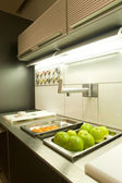 Part of kitchen with fruits — Stock Photo