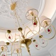 Beautiful chandelier with lampshades in a room — Stock Photo